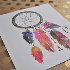 With flowing feathers and artfully painted details, this watercolor dream catcher print will brighten up the decor of a home, office or nursery in no time at all. Each print is carefully made in Calif