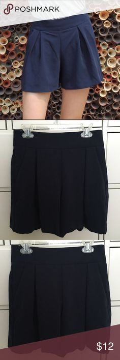 Navy Blue Flare Shorts Navy blue shorts from Uniqlo with stretchy band and small zipper on the back. Has pleats and pockets. Can be day or night. Uniqlo Shorts Skorts