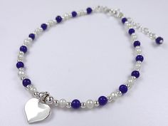 £12.50  Beautiful combination bracelet with sterling silver, fresh water pearls, lapis lazuli and fine sterling silver heart charm detail.  For more details please visit :  http://www.houseofaudrey.co.uk/bracelets/823-sterling-silver-fresh-water-pearls-lapis-lazuli-bracelet.html