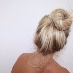 Pale buttery blonde highlighted hair in a bun