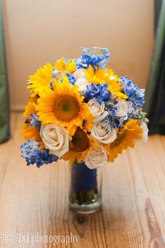 Sunflower wedding bouquet - this would be pretty with a darker blue accent flower. Bridal bouquet - you like?