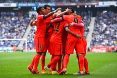 FC Barcelona players celebrate after Lionel Messi of FC Barcelona scored his team's second goal during the La Liga match between RCD Espanyol and FC Barcelona at Cornella-El Prat Stadium on April 25, 2015 in Barcelona, Catalonia.
