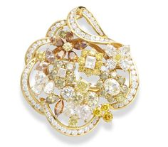 A diamond and fancy-coloured diamond brooch/clip/pendant, by David Morris.