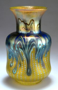 Johann Loetz Wwe., Klostermühle. Phänomen vase, 1900. H. 19.3 cm. Cased glass, milky yellow and clear, silver-yellow dashed lines, above them blue and silver-yellow threads, Phänomen Gre 353, designed by Franz Hofstötter for the Paris World Fair 1900, matt mother-of-pearl lustre.   |  SOLD 13,500 EUR, 2011