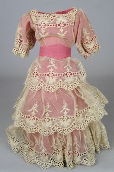 This is a wonderful doll dress that would be appropriate for either a French or German fashion type doll.  Circa 1920s, it is mostly all handsewn.