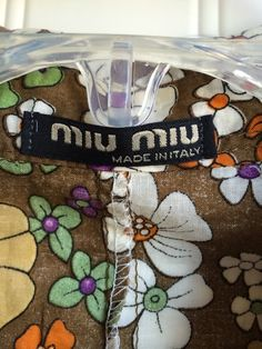 prada black leather handbag - Fake Miu Miu label. Logo stitching is crooked. | Fake Fashion ...