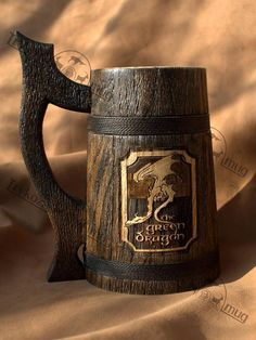The Green Dragon wooden Beer Mug 0.7 l (23oz), natural wood, handmade, wedding gift, beer tankard, gift for father of groom, grooms gift, gift for him. This handcrafted beer mug is made from real oak wood.  This mug has been thoroughly sealed for a finish that is alcohol resistant and heat safe up to 150 degrees F. Can be used for a beer, water and other cold and hot beverages. Outside, it is covered with a water-based varnish. Mug is waterproof.  Сapacity - 0.7L (23.66982us fl oz) Height…