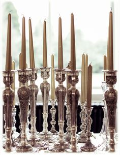 thousands of these everywhere for a party in lake como..Antique Silver Candlesticks