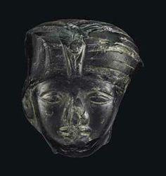AN EGYPTIAN OBSIDIAN HEAD OF A QUEEN MIDDLE KINGDOM, 12TH DYNASTY, CIRCA 1850 B.C.