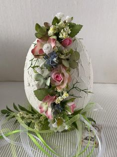 """Diameter cm height 20 cm """"broken"""" egg treated with structural paste, stands on a glass coaster decorated with all kinds of silk flowers and leaves, ribbons and small pendant Egg Crafts, Easter Crafts, Decor Crafts, Diy And Crafts, Diy Easter Decorations, Christmas Decorations, Diy Osterschmuck, Diy Ostern, Egg Art"""
