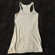 Sequin Tank Top Silver tank top with sequins. Perfect for going out paired with a leather jacket or during summer! In great condition. Everything is cheaper when bundled or on M! American Eagle Outfitters Tops Tank Tops