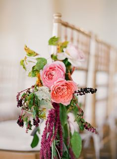 pretty florals tied to chairs | Floral Design: Joy Thigpen | Photography: Eric Kelley
