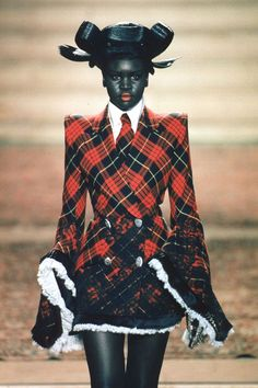 Alex Wek model - Alexander McQueen for Givenchy Haute Couture 'Eclect Dissect', F/W 1997/1998, Modern Geisha hair style. CREDITS: Hair styles and headwear by Nicolas Jurnjack, Makeup by Val Garland, Styling by Katy England