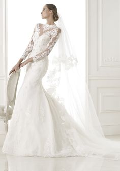 Pronovias 2015 Collection - High neck neckline wedding dress.  Available at Designer Bridal Room
