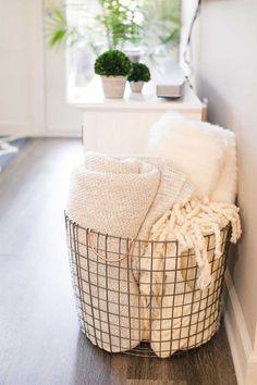 Wire blanket storage. White blankets, farmhouse decor, neutral, white, hardwood floor, living room, bedroom #afflink