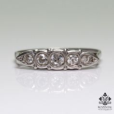 Period: Art Deco (1920-1935) Composition: Platinum. Stones: • 5 Old mine cut diamonds of H-VS2/SI1 quality that weigh 0.30ctw. Ring size: 7 Ring face: 17mm by 4mm Rise above finger: 3mm. Total weight: