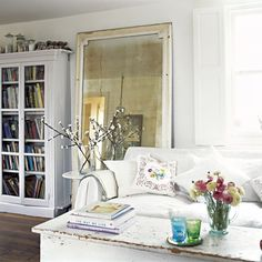 Vintage mirror, glass fronted bookcases, white, fresh flowers , shabby table - House to Home