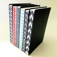 coptic stitch journals with decorative spines by Canteiro de Alfaces #bookbinding