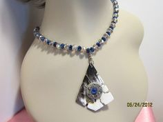 Wire wrapped petrified wood pendant and swarovski by jeepbut, $39.99
