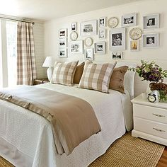 Khaki Gingham Guest Bedroom | In this bedroom, classic patterns directed the color palette and design style. The bed is flanked by a pair of small-scale chests that add extra storage conveniently at bedside. Matching frames filled with a collection of family photos decorate the wall in a random pattern.