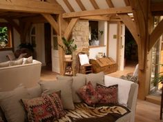 A mix of materials in this oak framed home adds to the character and cosy feel. By Roderick James Architects Living Place, Living Area, Living Room, Open Floor Concept, Oak Framed Buildings, Oak Frame House, Cosy Room, Barn Renovation, Country House Interior