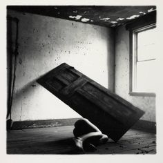 Francesca WOODMAN :: Untitled, 1975-80 [Woodman has carefully balanced a door at an unusual angle across the room, and hidden herself underneath creating an unsettling sense of claustrophobia. This image is from a series of photographs using doors as props, made while a student in New York.]