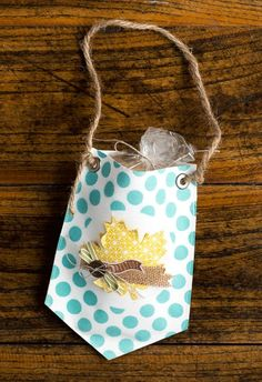 I found this on stampinup.com  This cute little pouch was made using two of the pennants from the Build a Banner Simply Created Kit, Item #133507, Price $19.95.   The leaf is from the Thankful Tablescape Simply Created Kit, Item #133643, Price $19.95 You can order supplies online at joycefisher.stampinup.net