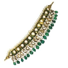 Emerald, Natural Pearl and Diamond 'Guluband', Rajasthan, 18th/19th century Composed of eleven square plaques, each decorated with kachnar ki patti green translucent enamel and set with a pear-shaped foil-backed diamond, bordered by natural pearls and supporting a deep fringe of emerald beads, natural pearls and similarly set diamond drops, the reverse of the mounts with safed chalwan enamel depicting red poppy plants and flowerheads, mounted in gold