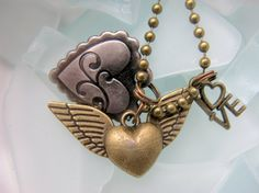 Charm necklace with hearts and love by EyeCandiShoppe on Etsy