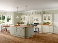 Gallery Rockfort Shaker Kitchen shown in stone finish base and wall units with island in olive