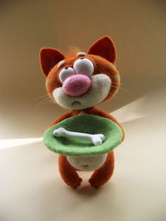 I love this cat, he's so funny ! http://www.etsy.com/listing/75376147/felted-funny-cat
