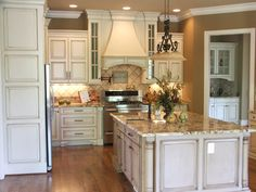 This kitchen pulled out all the stops! What would you change about it? Custom cabinets by Dixon Custom Cabinetry in Kernersville, NC #loveit