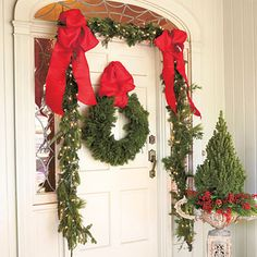 Add color to your front door with an evergreen wreath and bright ribbon.