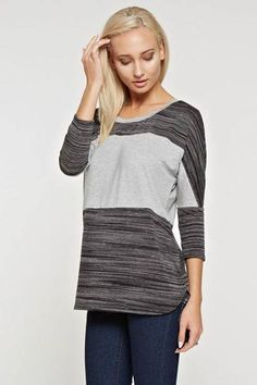 7077d01fcd7 ... Bridesmaid dresses. See more. A 3 4 sleeve round neck color block knit  top with dolman sleeves featuring a