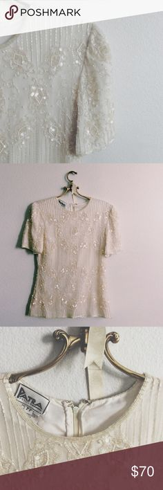 ✨ Sparkly bead, pearl and sequin cream Holiday top All beading, pearls and sequins are intact.  SO BEAUTIFUL  beading in the front and in back.  Such a high quality piece.  Shell is 100% Silk.  Lining is 100% Polyester.  Made in India.  Zip back.  Please note there are 3 beads in the back they are dark colored beads, not sure why but is not too noticeable. Size on tag is PP. Patra Tops Blouses