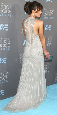 KATE BECKINSALE selects a shimmering silver Monique Lhuillier gown with Art Deco details, Butani chandliers and a sleek Kotur clutch for the Critics' Choice Awards.