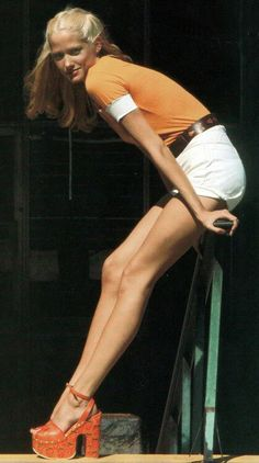 Love the orange t-shirt which screams the 70s all over. The chunky heels tie the outfit together! #inspiration #Yoursclothing #70s