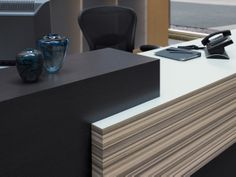 Formica Laminate 8839 Ashen Ribbonwood and 8829 Graphite Twill compliment each other nicely on this office receptionist desk. What could you do with these in your kitchen?