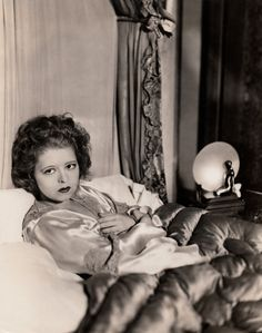 """Bow in Bed ☆ Clara Bow ☆ Original photograph circa 1931 ☆ Written in pen on reverse: """" Clara Bow, ill from the strain of watching her dear friend tried for theft - This picture was really taken in her own bedroom, while Clara was suffering from the..."""