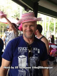 Michael Rooker - Merle wearing a TARDIS shirt and a pink hat.