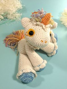 Hermione the unicorn by Dawn Toussaint. I really need to learn how to crochet again so I can make this!
