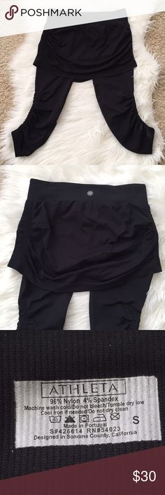 """New Listing{Athleta} Seamless Skirts Got Legs {Athleta} Seamless Skirts Got Legs Size:S Color: Black. 2-in-1 Skirt with Capri attached. Waist measures 13.25"""" when flat, and does stretch. Total length: about 24"""" from top of waist to longest point of leg bottom when laid flat. Worn once. In excellent condition with no pilling or flaws. Athleta Shorts"""