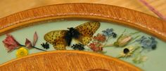 Detail on our Betty Roberts spinning wheel - inset butterfly