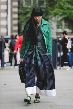 In spite of the downpours and semi-chilly weather, London Fashion Week show-goers served up a large dose of irreverent dressing over the past few days. Off the runway, street style stars showed off the country's eclectic, home-grown talent — labels like Ashley Williams, Shrimps, Simone Rocha, and