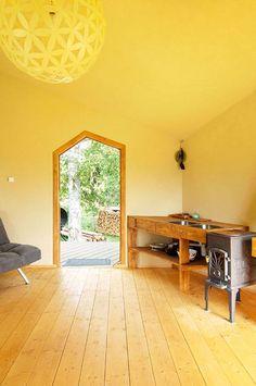 Six-sided modular cabin by Jaanus Orgusaar with wooden walls and fisheye windows