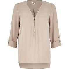 Light pink zip-up neck blouse