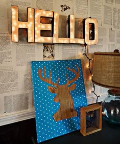 Easy DIY Lighted Letter Sign....also like the book pages as wall paper in the background