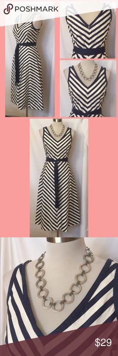 Jones New York Signature navy/cream, chevron dress This dress is truly ladylike and reminds me of a bygone era. It will never go out of style. I would love this with pearls and a straw hat, but it can easily be thrown on with some flat sandals and beads. The material is a breathable cotton canvas type, but it is not stiff at all and resists wrinkling somehow. Comes with matching tie belt. Excellent condition. Jones New York Dresses