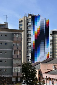 "Argentinian-Spanish artist Felipe Pantone creates public murals that integrate black and white patterns with bright sweeping color spectrums. His tag ""Pantone"" is an evolution of his original name ""Pant"" chosen when he was just thirteen, a complete coincidence despite his color-rich works. His mash-"