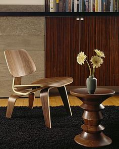 True classics. Eames Molded Plywood Chair and Walnut Stool.